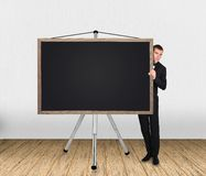 Businessma and blank blackboard Stock Image