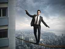 Businessma van Equilibrist royalty-vrije stock afbeelding