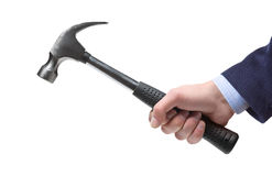 Businessman's hand holding a hammer. A businessman's hand holding a hammer isolated on a white background Stock Images