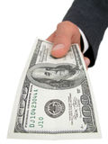 Businessman�s Hand Offering One Hundred Dollar Bill Stock Photos