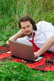 Businessman. Working in a meadow with laptop Stock Photos