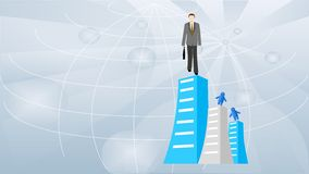 Businessman. Stands on the top of the building Stock Photo