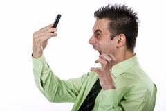 Businessman. Angry businessman screaming on the phone Royalty Free Stock Image