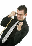 Businessman. Angry businessman screaming on the phone Stock Image