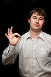 Businessman. Man with ok sign on black Stock Photo