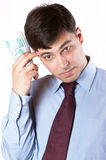 Businessman. Bewildered business man with a bundle of cash in hand Stock Image