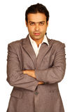Businessman. Portrait of an Indian business man isolated over white background. Studio shot stock photography