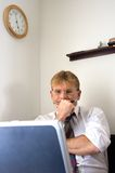 Businessman. A businessman trying to get his work done Stock Images