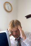 Businessman. A businessman that is either deep in thought or very tired Royalty Free Stock Photography