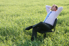 Businessman. Relaxing on the meadow Royalty Free Stock Photography