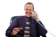Businessman 2. Businessman making a credit card purchase by phone stock photo