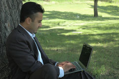 Businessman 2. Businessman in park with laptop Stock Image