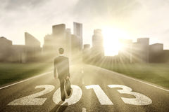 Businessman-2013-road-journey. Businessman is walking on the road to embrace new year 2013 Stock Photography