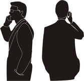Businessman. The man talks on telephone. discusses business meeting Royalty Free Stock Photo