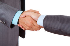 Businessman. Hands handshake isolated over white background Royalty Free Stock Images