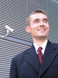 Businessman. Standing Outside a Modern Office Building Stock Image