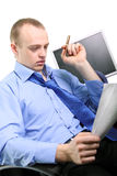 Businessman. Yong Businessman reading the documents royalty free stock images