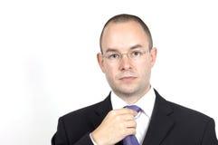Businessman. A businessman adjusts his tie Royalty Free Stock Photo