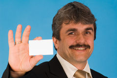 Businessman. A businessman with a business card Royalty Free Stock Image