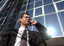 Businessman. Business call. Young businessman talking to the cell phone in front of an office stock photos