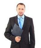 Businessman. Smiling modern businessman holding blank clipboard in hands isolated on white Royalty Free Stock Photography