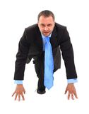 Businessman. Modern businessman in the starting line ready for another competition (isolated on white Stock Photo
