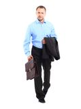 Businessman. Portrait of a happy young business man carrying a suitcase on white background Stock Images