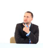 Businessman. Portrait of an handsome businessman looking and pointing his finger up Stock Photography