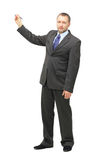 Businessman. Portrait of showing businessman, isolated on white Stock Photography