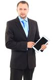 Businessman. Portrait of a businessman with a tablet computer against a white background Royalty Free Stock Photos