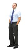 Businessman. Full length portrait of a young businessman standing with his hands in the pockets Royalty Free Stock Photography