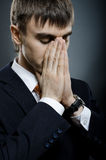 Businessman. Portrait  the  businessman careerist in black costume grieve and praying Stock Image