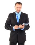 Businessman. Portrait of a businessman with a tablet computer against a white background Stock Photography
