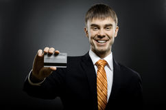 Businessman. Happy businessman reach out on camera and show credit card or visiting card, smile Royalty Free Stock Photography