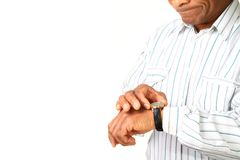 Businessman. Image of a businessman on the phone checking time Royalty Free Stock Photos
