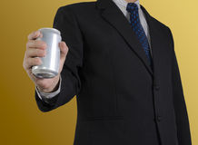 Businessman. Showing soft drink can ,  background Royalty Free Stock Photography