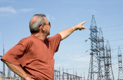 The businessman. The man on a background of electric substation Stock Image