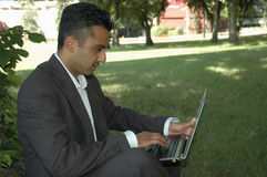 Businessman 3. Business man in the park with a laptop Stock Photos
