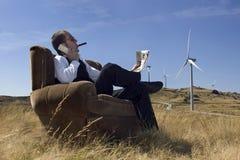 Businessman. Concept of renewable energy profit stock photography