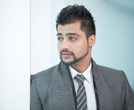 Businessman. Young Asian Indian businessman standing on office background Stock Images