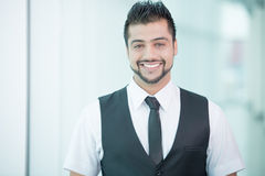 Businessman. Young Asian Indian businessman standing on office background Royalty Free Stock Photo