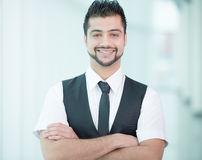 Businessman. Young Asian Indian businessman standing on office background Royalty Free Stock Photography