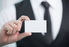 Businessman. Indian businessman holding business card, focus on hand in the office Stock Photos