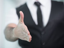 Businessman. Hand shaking. Indian businessman gives hand to greet Royalty Free Stock Photo