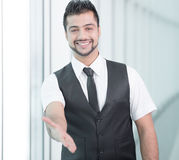 Businessman. Hand shaking. Indian businessman gives hand to greet Stock Photo