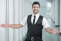 Businessman. Happy young businessman of India spreading his hands apart to welcome Royalty Free Stock Images