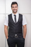 Businessman. Young Asian Indian businessman standing on office background Royalty Free Stock Image