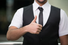 Businessman. Happy young Indian businessman with thumb up Stock Photography