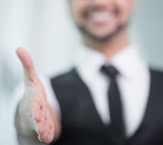 Businessman. Hand shaking. Indian businessman gives hand to greet Royalty Free Stock Photography