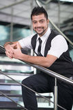 Businessman. Young Asian Indian businessman standing on office background Stock Image